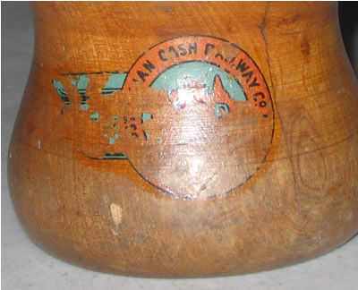 Wooden cup with Australian Cash Railway Company transfer